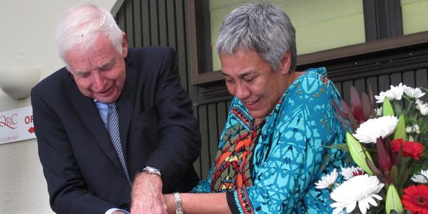 QRC chairman Sir Eion Edgar and NZ Maori Tourism chief executive Pania Tyson-Nathan cut the cake.