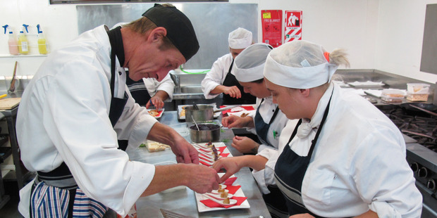 Chef tutor Mark Oliver, of Kawakawa, guides students as they prepare a batch of canapes.
