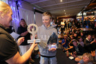 Celebration Time: Aucklander Seb Menzies receives his trophies at last night's prizegiving. Photo/Duncan Brown