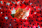 Brian Towgood (served in Malaya and Borneo) framed with Poppies. Photo / John Stone