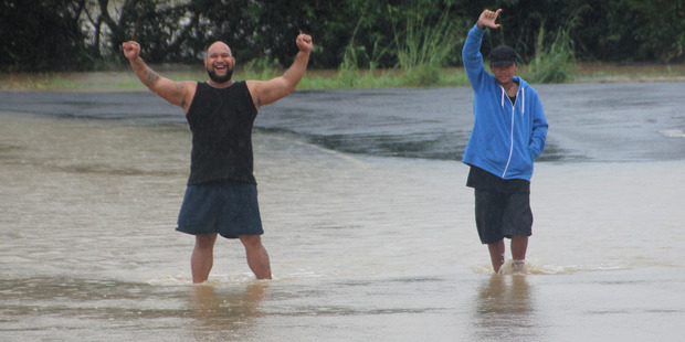 Noble Tua (left) and Michael Wilcox abandoned their car and make their way to Kaeo on foot to stock up on essentials in case Cyclone Cook pushed floodwaters even higher.