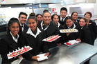 QRC hospitality management students with a round of canapés for guests at the culinary school's re-opening. PHOTO / PETER DE GRAAF