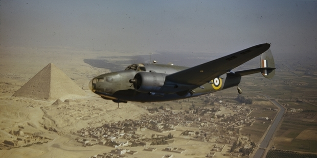 A Royal Air Force Lockheed Hudson Mk VI (AE626) of the Middle East Communications Flight flying over the pyramids. Photo / Imperial War Museum