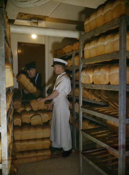 A naval rating collects bread for his mess from the battleship's bakery. Photo / Imperial War Museum