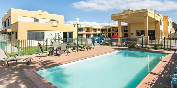 A view of the Deco City Motor Lodge across the swimming pool. Photo / Supplied