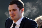 Paedophile footballer Adam Johnson has been caught on camera joking about his vile crimes with fellow inmates. Photo / Getty Images.