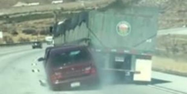Loading Shocking footage captured in the US shows a motorist trapped in his damaged car as a large truck drags it along a highway. Photo / Live Leak