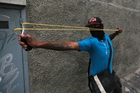 Protesters used slingshots and threw Molotov cocktails and rocks during the clashes in Caracas. Photo / AP