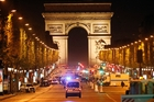 A policeman and the attacker were killed in the attack on the Champs Elysee in central paris. Photo / AP