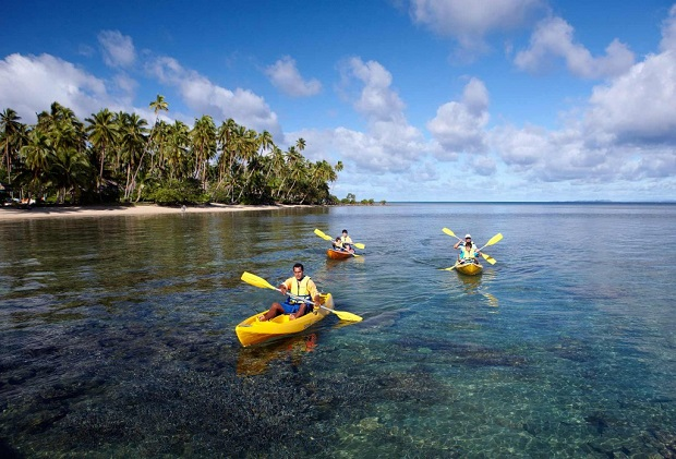 Guests explore the coastline of the island from kayaks.