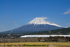 The icing-sugar cone of Mt Fuji inspires hunger as the Shinkansen train glides past. Photo / Getty Images