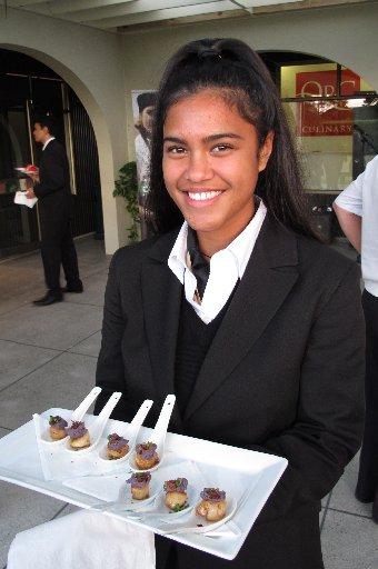 Hospitality management student Grace Callaghan (18, Te Whanau a Apanui) offers scallop canapés.