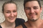 Matthew Henderson, 25, and girlfriend Laura Rose are grateful to the people from the car behind them who helped them get out of their vehicle after the almost deadly head-on crash near Waihi. Photo / Supplied