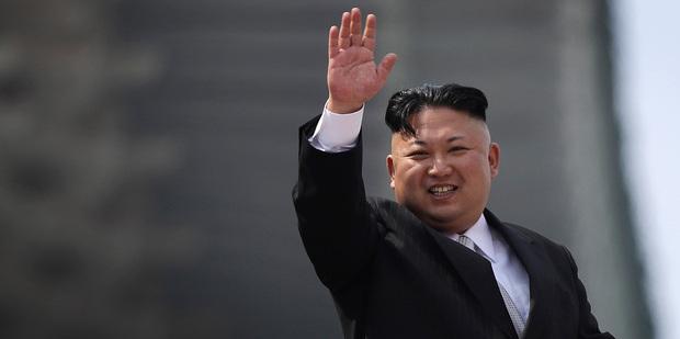North Korean leader Kim Jong-un waves during a military parade in Pyongyang. Photo/AP
