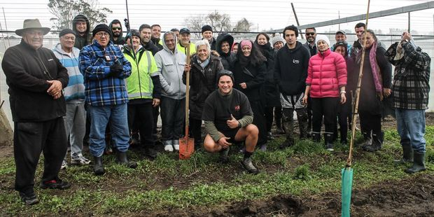 Residents of Matakana Island give the thumbs up after mucking in to help build Whai Orchard, part of a $30m investment to help build an enterprise for future Bay generations. Photo/supplied
