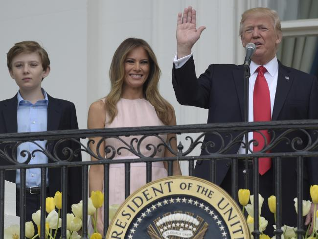 President Donald Trump, with first lady Melania Trump and their son Barron Trump, address the crowd at the annual White House Easter Egg Roll. Photo/AP