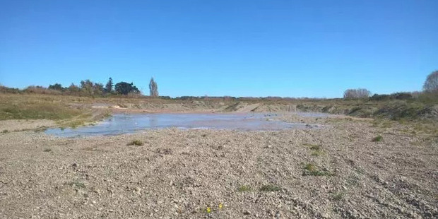 The waters of the Selwyn River crept back over formerly dry gravel following recent rainfall. Photo / Christchurch Star