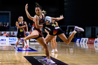 Erikana Pedersen of the Tactix and the Magic's Casey Kopua perform an interpretive dance. Photo / Photosport