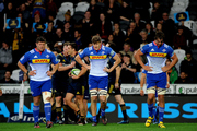 Stormers players look dejected as the Highlanders celebrate. Photo / Photosport