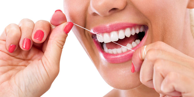 Use interdental brushes or floss at least once a day. Photo / 123RF