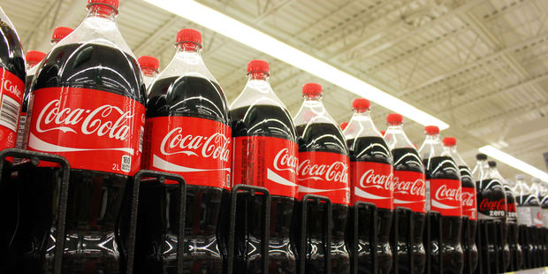 The Queen is said to be partial to the odd Coca-Cola. Photo / 123RF