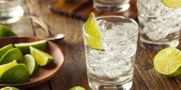 The Queen has been known to drink a glass of straight gin before lunch. Photo / 123RF