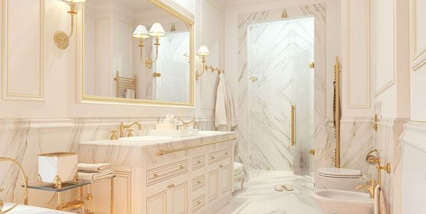Trade off: The other bathrooms in the villas feature less fancy tubs, but there's plenty of marble cladding to make up for it. Photo / XXII Carat