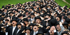 5. Where did 662 people recently take part in a Charlie Chaplin look-alike world record? Photo / AP