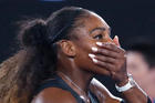 Serena Williams covers her face after defeating her sister, Venus, in the women's singles final at the Australian Open. Photo / AP
