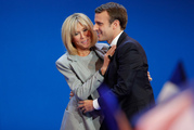 French centrist presidential candidate Emmanuel Macron and his wife Brigitte hug in Paris. Photo / AP
