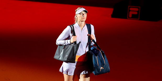 Russia's Maria Sharapova enters the court for her match against Italy's Roberta Vinci at the Porsche Grand Prix. Photo / AP