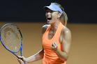 Maria Sharapova reacts during her match against fellow Russian Ekaterina Makarova. Photo / AP
