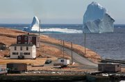 A large iceberg is visible from the shore in Ferryland, an hour south of St. John's, Newfoundland. Photo / AP