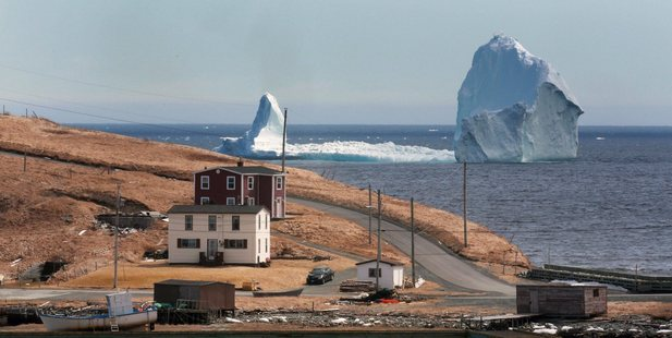Loading A large iceberg is visible from the shore in Ferryland, an hour south of St. John's, Newfoundland. Photo / AP