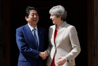Britain's Prime Minister Theresa May welcomes Prime Minister Shinzo Abe. Photo / AP