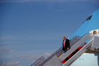 President Donald Trump walks down steps of Air Force One. Photo / AP