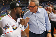 Marlins owner and CEO Jeffrey Loria, right, congratulates Marlins' player Marcell Ozuna. Photo / AP