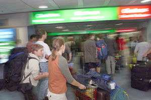 Arriving passengers head for customs declaration lanes at the Auckland International Airport arrivals hall. Photo / File