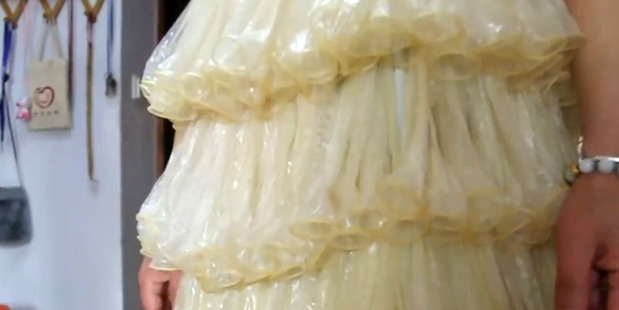 The dress has no fewer than 3000 individual condoms on it. Photo / Australscope