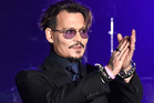 Johnny Depp is laying the blame on other people for his elaborate spending habits. Photo / Getty Images