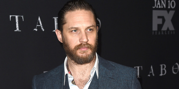 Tom Hardy proving not all heroes wear capes. Photo / Getty Images