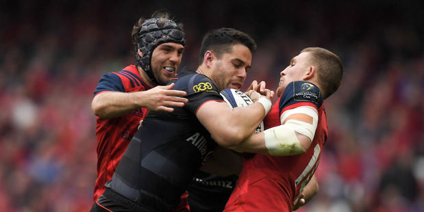 Sean Maitland of Saracens is tackled by Duncan Williams, left, and Andrew Conway of Munster. Photo / Getty