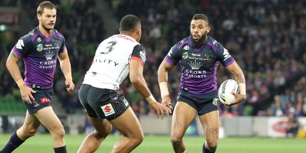 Josh Addo-Carr of the Melbourne Storm eyes up a Warriors defender. Photo / Getty