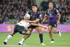 Nelson Asofa-Solomona of the Storm runs with the ball against the Warriors. Photo / Getty Images