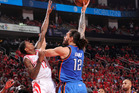 Steven Adams shoots the ball over Lou Williams of the Houston Rockets. Photo / Getty