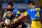 North Queensland's Antonio Winterstein is tackled by Parramatta's Kirisome Auva'a during last night's 26-6 win for the Eels over the Cowboys in Townsville. Photo / Getty Images.