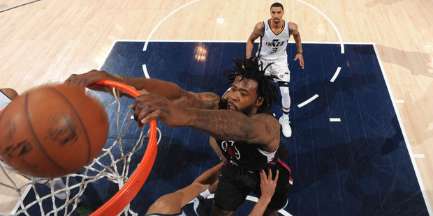 DeAndre Jordan of the Los Angeles Clippers dunks on Rudy Gobert of the Utah Jazz. Photo / Getty