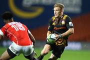 Damian McKenzie scored a brace of tries in the Chiefs' win over the Sunwolves. Photo / Getty