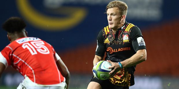 Loading Damian McKenzie scored a brace of tries in the Chiefs' win over the Sunwolves. Photo / Getty