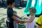 Kolberg's son Carson is seen sharing his toys with his friend at the park. Photo / Facebook